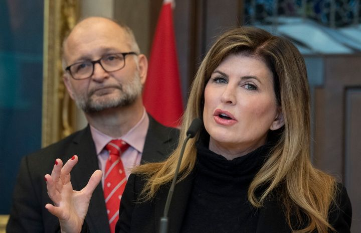 Attorney General  David Lametti looks on as Rona Ambrose speaks about a government bill that would require federal judges take sexual assault law training. They made the announcement in Ottawa, on  Feb. 4, 2020.