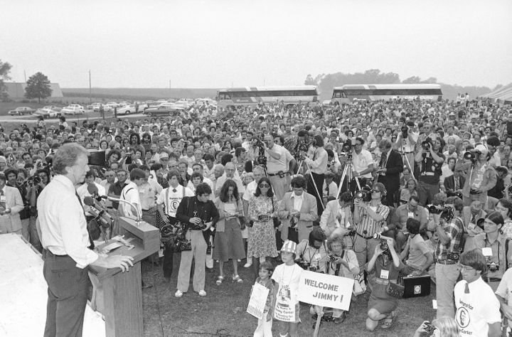Then-presidential candidate Jimmy Carter speaks to a crowd of supporters on the Van Ryswyk farm in Des Moines, Iowa, on Aug.
