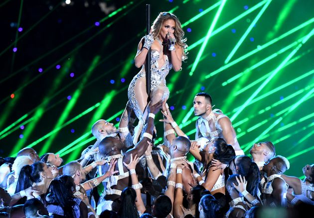 Jennifer Lopez clings to the pole during her Super Bowl