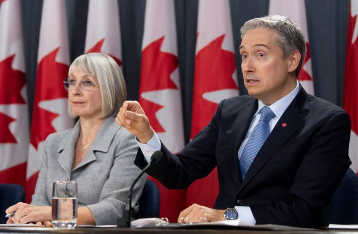 Minister of Health Patty Hajdu looks on as Foreign Affairs Minister Francois-Philippe Champagne responds to a question during an update on the coronavirus situation on Feb. 3, 2020 in Ottawa.