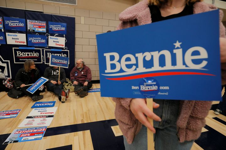 Supporters of Sen. Bernie Sanders (I-Vt.) wait at their caucus site in Des Moines on Monday. Iowans are defensive of the cauc