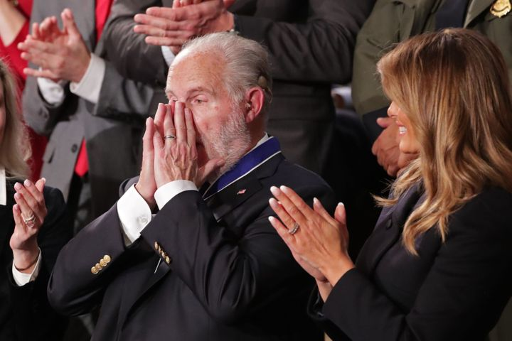 Conservative radio talk show host Rush Limbaugh reacts as he is awarded the Presidential Medal of Freedom by U.S. First Lady