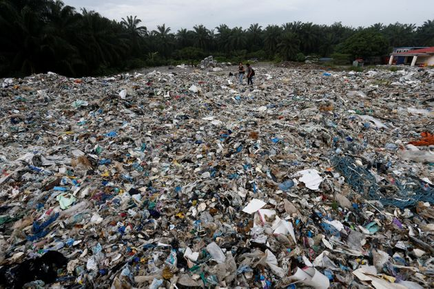 Plastic waste are piled outside an illegal recycling factory in Jenjarom, Kuala Langat, Malaysia on Oct....