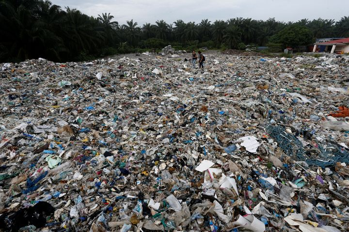 Plastic waste are piled outside an illegal recycling factory in Jenjarom, Kuala Langat, Malaysia on Oct. 14, 2018.