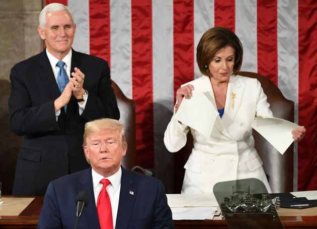 US Vice President Mike Pence claps as Speaker of the US House of Representatives Nancy Pelosi appears...