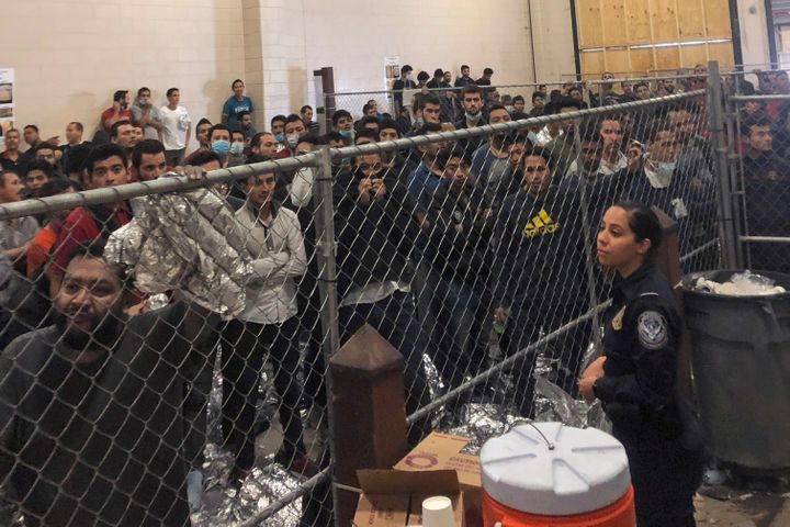 People forced to stand in small, enclosed spaces at a detention center in McAllen, Texas, during a visit by Vice President Mi