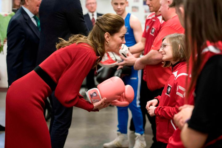 The duchess chats with a girl during a visit to a boxing club in Port Talbot. Check out those pink gloves!