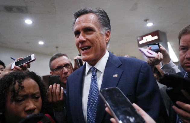 Sen. Mitt Romney speaks to reporters upon arrival for the Senate impeachment trial on Jan. 29, 2020 in...