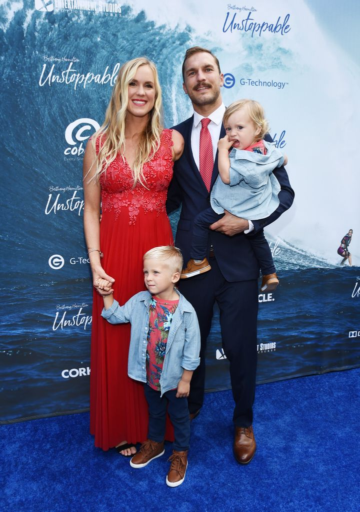 Hamilton, Adam Dirks and their sons Tobias and Wesley attend the Los Angeles premiere of