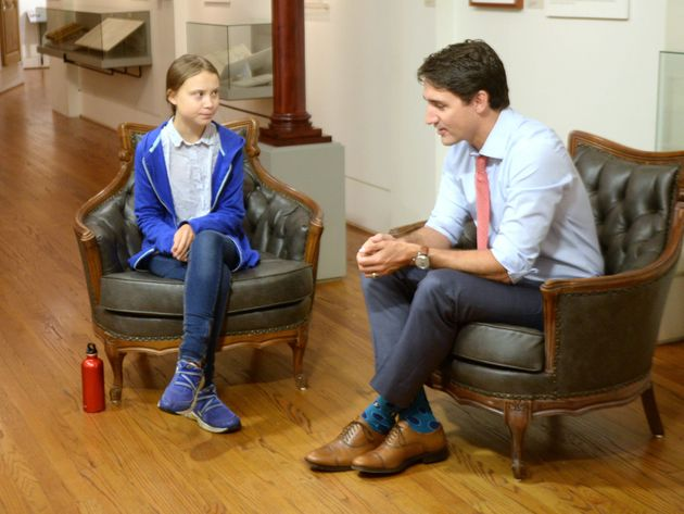Justin Trudeau speaks with Swedish environmental activist Greta Thunberg in Montreal on Sept. 27,