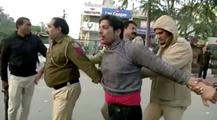 Kapil Gujjar (being detained by Delhi Police in the image) opened fire at Shaheen Bagh on February 1, just a week before the Delhi election.