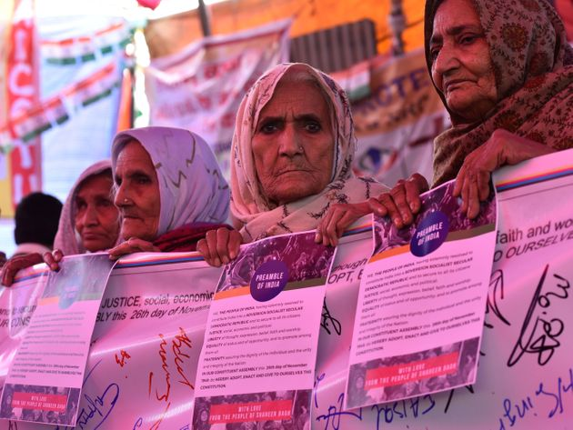 Women hold posters of the preamble to the Constitution during the ongoing protest against Citizenship...