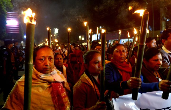 Activists of All Assam Students Union (AASU) along with 30 organisations taking out a torchlight rally protest against Citizenship Amendment Act (CAA) in Guwahati, Assam on January 11, 2020.