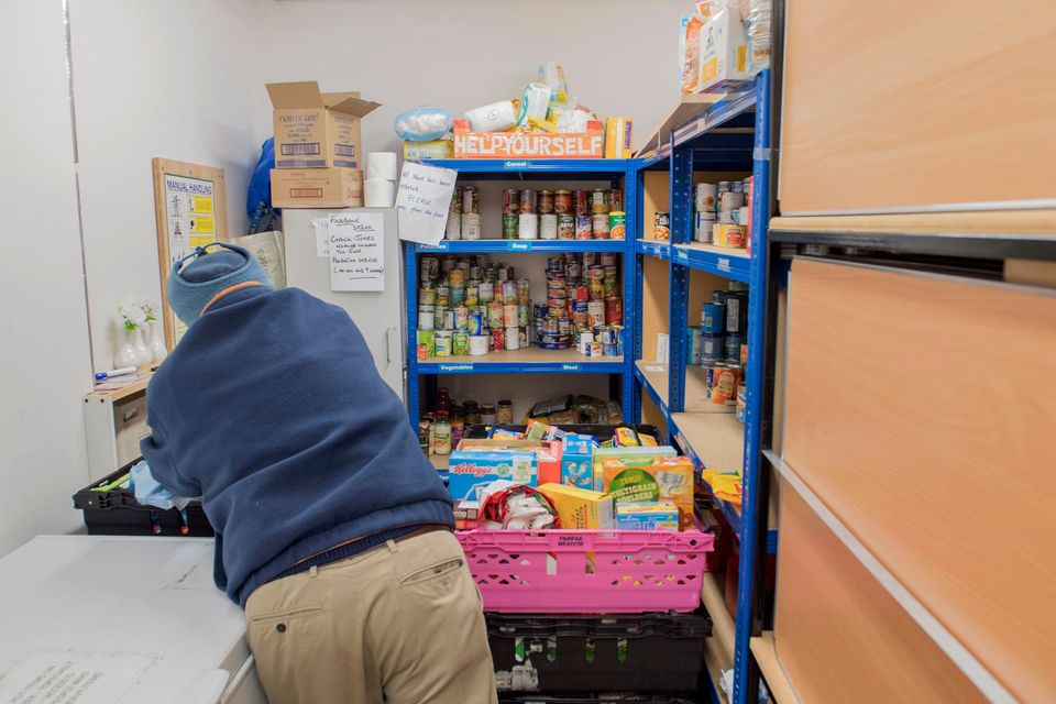A foodbank volunteer stores donations at St John's Church before distributing them to local foodbanks...