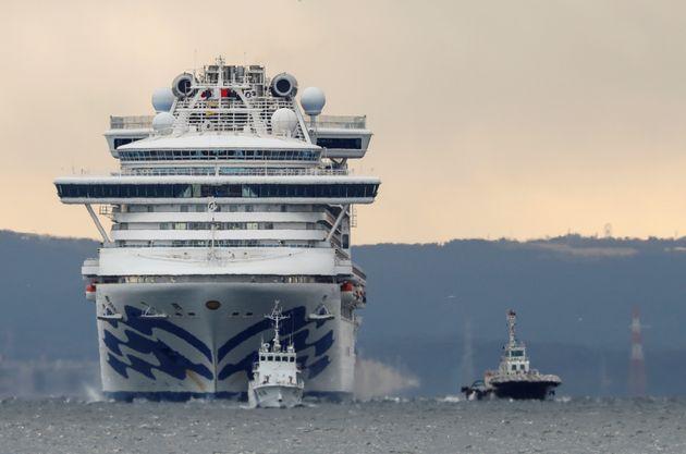 The Diamond Princess cruise ship is seen here off the coast of Yokohama, Japan, on Thursday. The company...