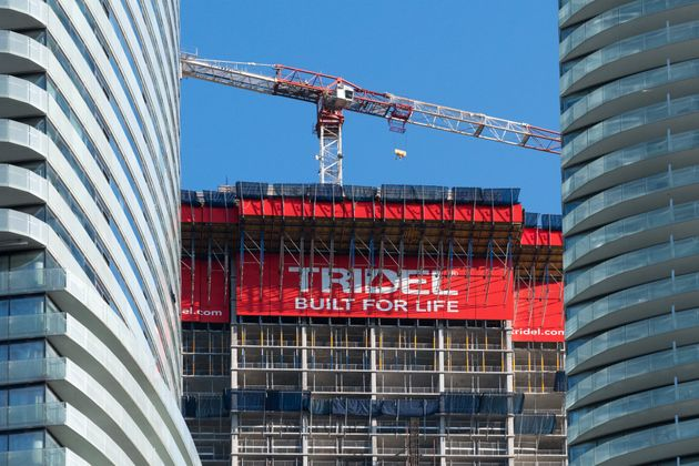 A Tridel sign is seen here as a crane works on a condo development in Toronto in 2017. The Toronto Regional...