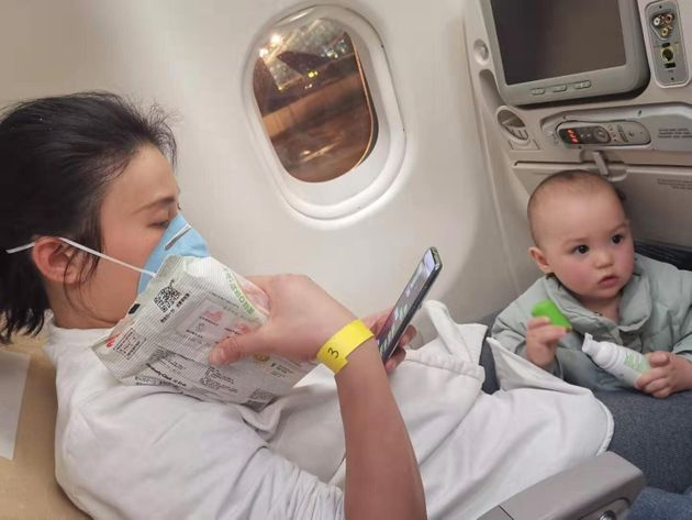 Summer Wu and her one-year-old son Felix wait on a plane destined for Canada to leave the Wuhan Tianhe...