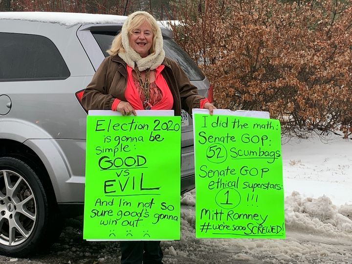 A woman stood outside Pete Buttigieg's town hall in Merrimack, New Hampshire, to give thanks to Sen. Mitt Romney for voting t