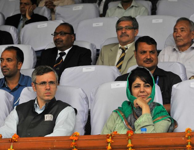 Former Chief Minister Omar Abdullah (L) and People's Democratic Party President Mehbooba Mufti (R) on...