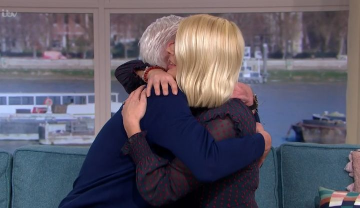 Holly gave Phillip a big hug after their interview