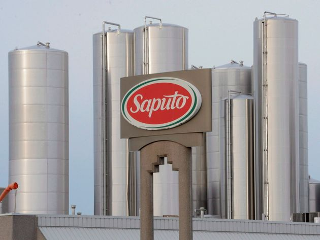 A Saputo sign is seen here in 2014 at a plant in Montreal. The company says it plans to diversify its...
