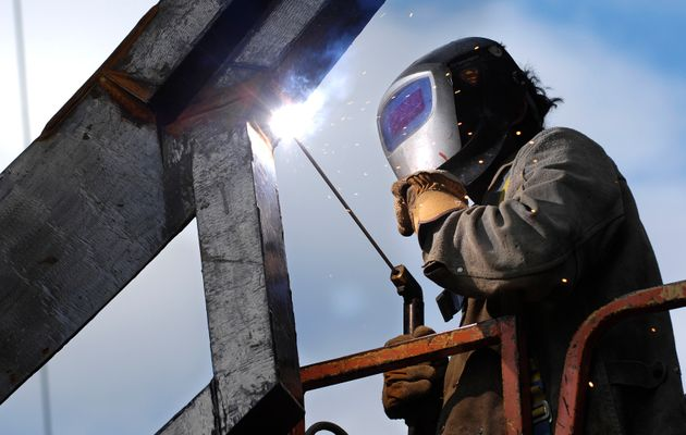 A welder works on a condo development in Toronto in this undated photo. Canada's construction sector...