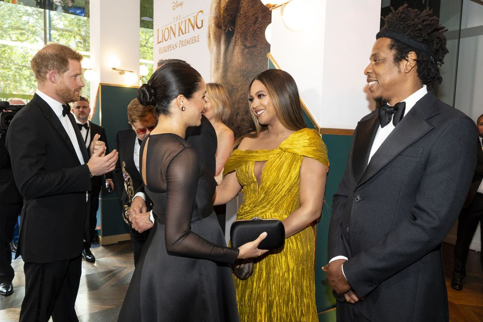 "Meghan and Harry greet Beyoncé and Jay-Z as they attend the European premiere of Disney's ""The Lion King"" in London on"