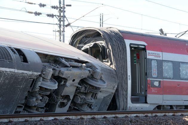 ROME, Feb. 6, 2020 -- Photo shows a derailed train near Lodi, Italy, Feb. 6, 2020. A high-speed train...