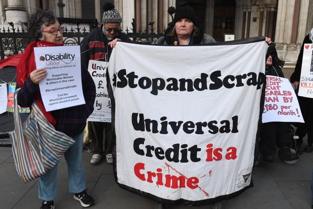 Campaigners outside the Royal Courts of Justice in London supporting the legal challenge against the...