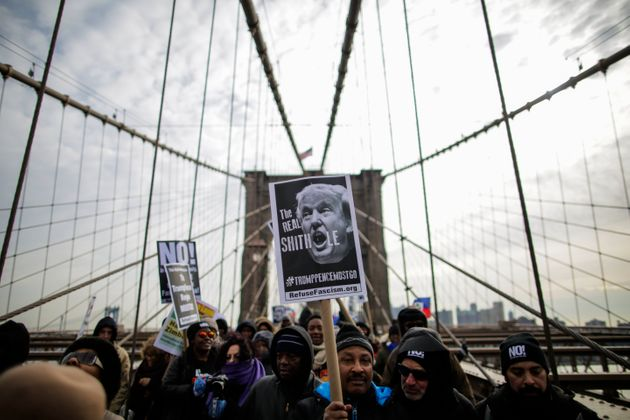 People take part in a protest against U.S. President Donald Trump on Jan. 19, 2018, shortly after his...