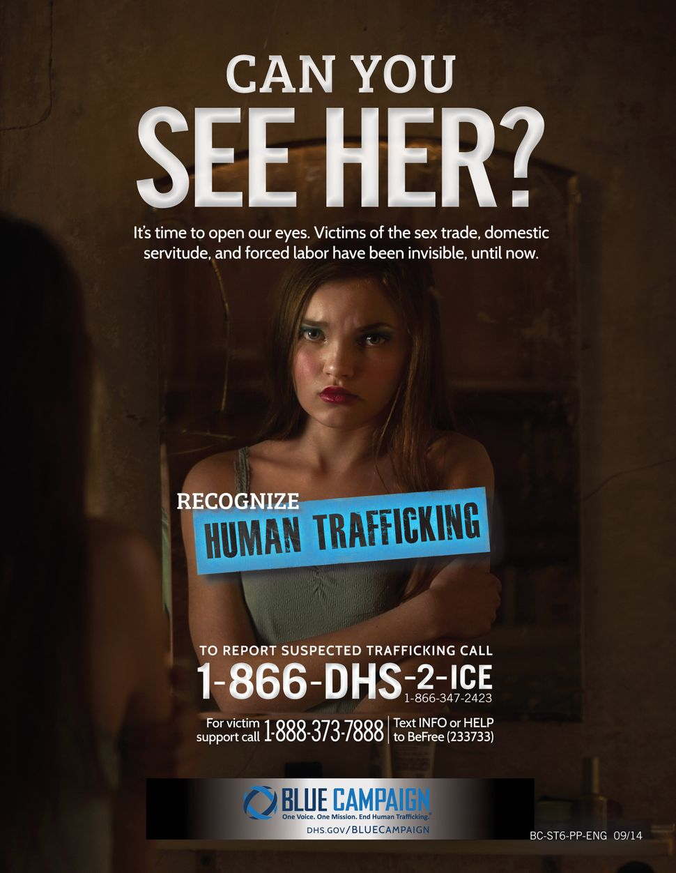 A Department of Homeland Security human trafficking awareness poster directs callers to an ICE