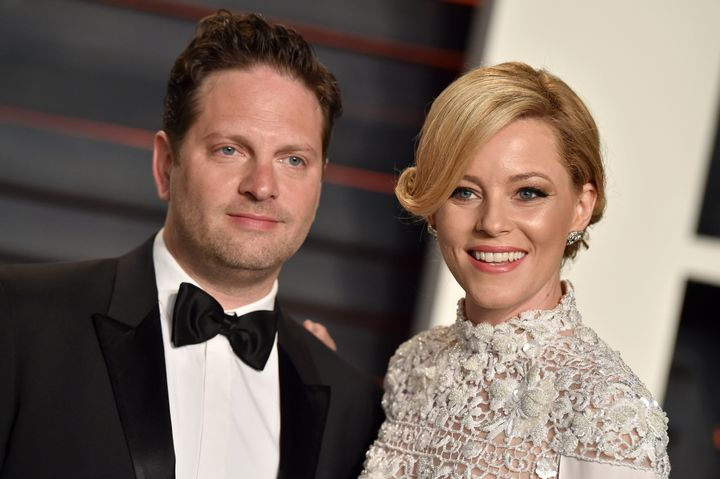 Elizabeth Banks and her husband, Max Handelman, were college sweethearts who wed in 2003. Here, they arrive at the 2016 Vanity Fair Oscar party in Beverly Hills, California.
