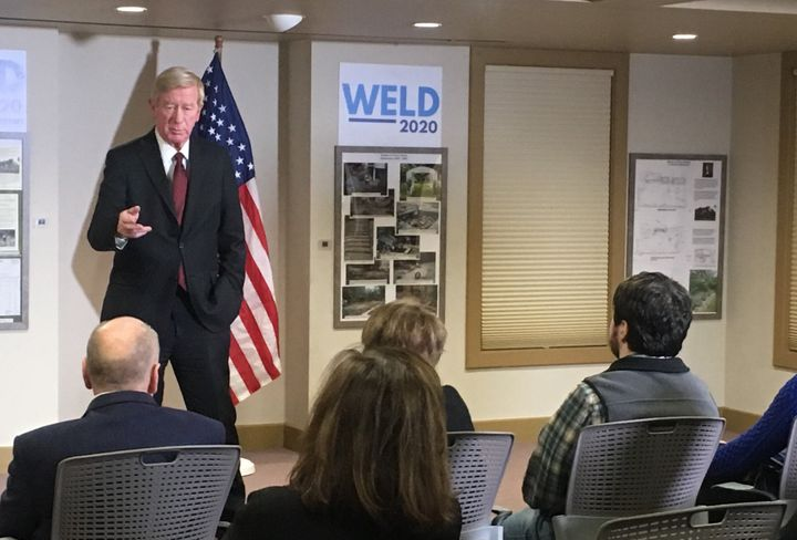 Former Massachusetts Gov. Bill Weld speaks to voters at the New London, New Hampshire, public library on Friday ahead of Tues