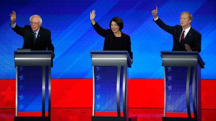 Democratic presidential candidates from left, Sen. Bernie Sanders, I-Vt., Sen. Amy Klobuchar, D-Minn., and businessman Tom St