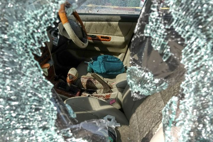 SENSITIVE MATERIAL. THIS IMAGE MAY OFFEND OR DISTURB Bullet holes and blood are seen in a victim's car following a gun battle involving a Thai soldier on a shooting rampage, in Nakhon Ratchasima, Thailand, February 9, 2020. REUTERS/Athit Perawongmetha