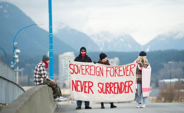 Protesters block the road access to one of Vancouver's port entrances in Vancouver on