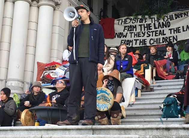 Indigenous pipeline protester Kolin Sutherland-Wilson speaks at an anti-pipeline rally in Victoria on