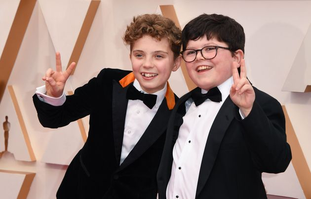 British actors Roman Griffin Davis and Archie Yates arrive for the 92nd Oscars at the Dolby Theatre in...
