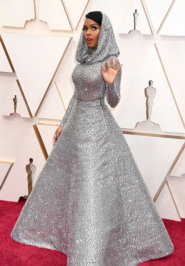 Janelle Monáe stops to pose on the red carpet as she attends the 92nd Annual Academy Awards on...