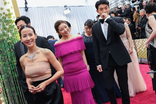 Actors of the Korean movie Parasite Yeo-jeong Jo (L), So Dam Park (C) and Woo-Sik Choi arrive for the...
