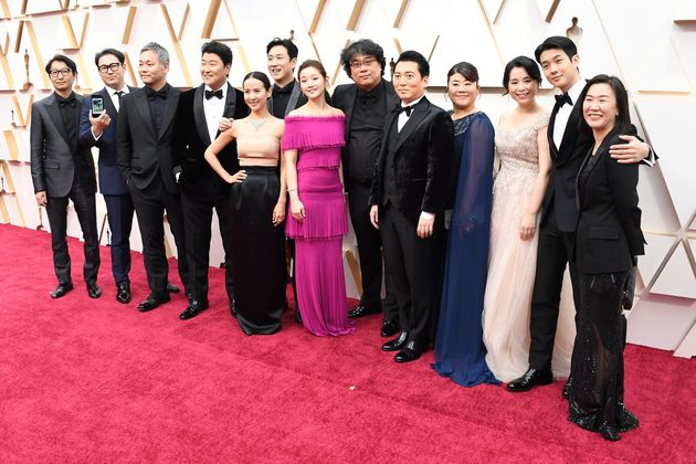 HOLLYWOOD, CALIFORNIA - FEBRUARY 09: Parasite cast and crew attends the 92nd Annual Academy Awards at...