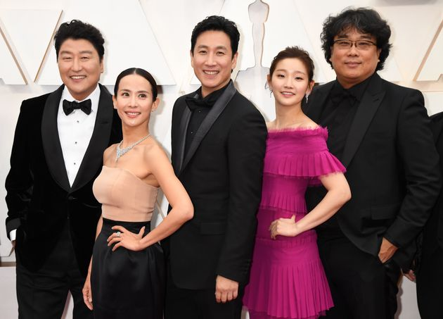 HOLLYWOOD, CALIFORNIA - FEBRUARY 09: Director Bong Joon-ho (R) with cast and crew of