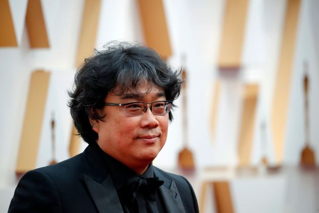 Parasite director Bong Joon Ho poses on the red carpet during the Oscars arrivals at the 92nd Academy...