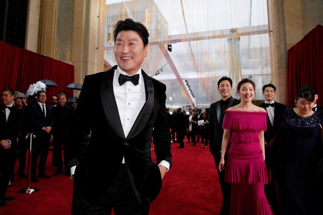 South Korean actor Song Kang-ho and the cast of Parasite pose on the red carpet during the Oscars arrivals...