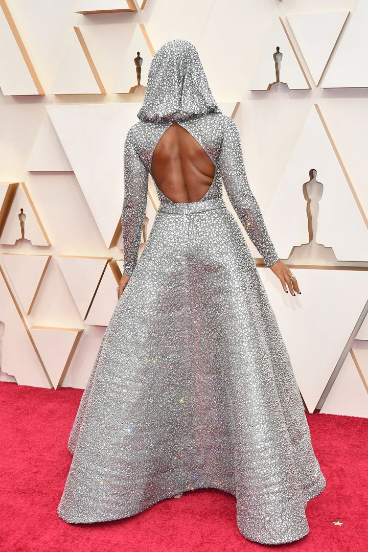 Monáe showed the detail of her custom Ralph Lauren gown on the Oscars red carpet on Sunday in Los Angeles.