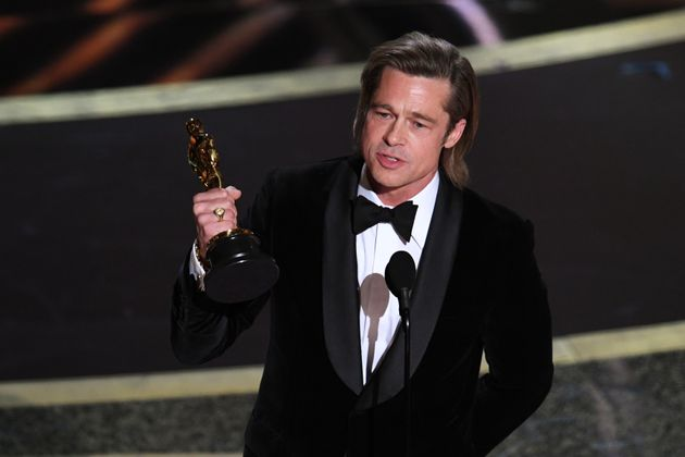 Brad Pitt accepts the Actor in a Supporting Role award for