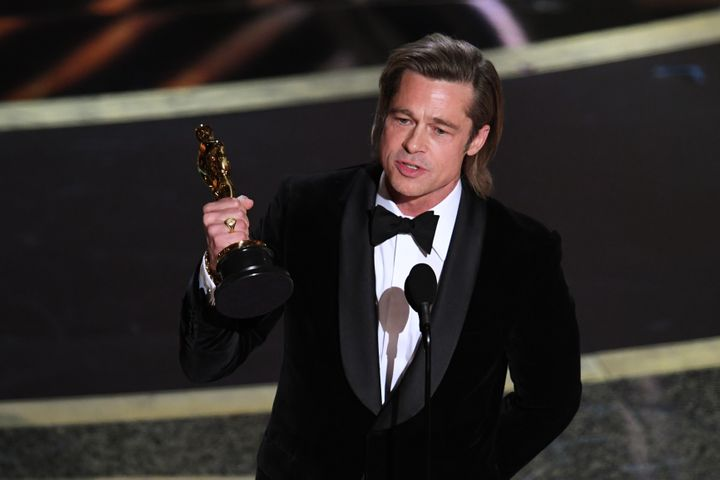 """Brad Pitt accepts the Actor in a Supporting Role award for """"Once Upon a Time...in Hollywood"""" onstage during the 92nd Annual A"""