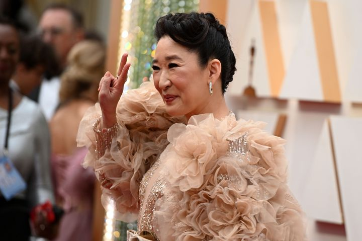 Sandra Oh arrives with her enormous sleeves for the 92nd Oscars at the Dolby Theatre in Hollywood on Sunday.