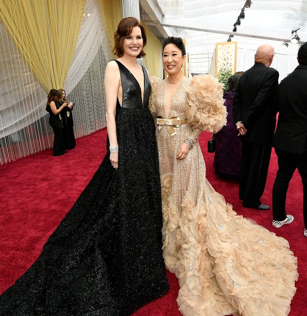 You know when you can hold your own against Geena Davis' dramatic look that your dress is, in a word,