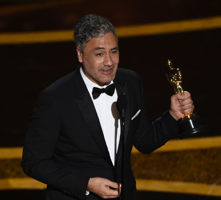 "Taika Waititi accepts the award for Best Adapted Screenplay for ""Jojo Rabbit"" at the Oscars."